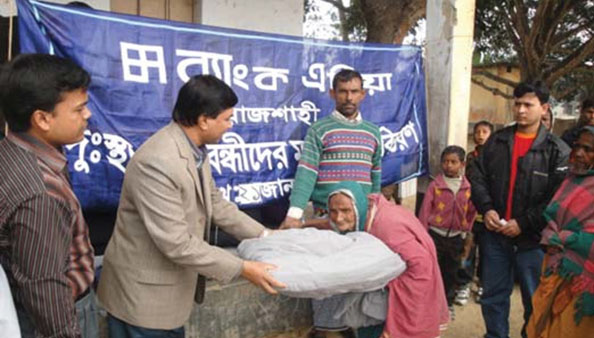Distribution of warm cloths among cold-hit distressed people in Rajshahi