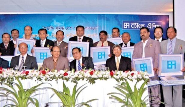 The Governor of Bangladesh Bank inaugurates distribution of computers for CLCs